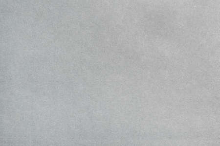 A sheet of gray paper with a non-uniform color. Neutral paper texture.