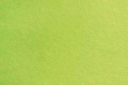 A sheet of colored paper with a non-uniform color. Neutral paper texture.