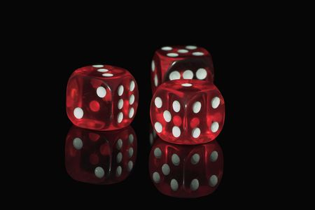 Three red casino dices on the black background Stock Photo - 1222782