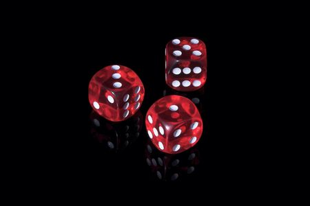 Three red casino dices on the black background Stock Photo - 1222784