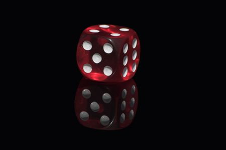 Red casino dice on a black background photo