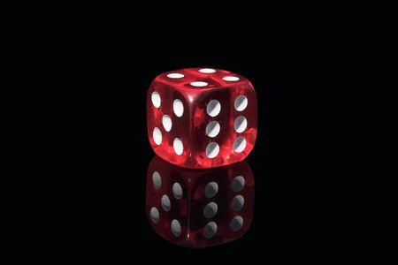 closeups: Red casino dice on a black background Stock Photo