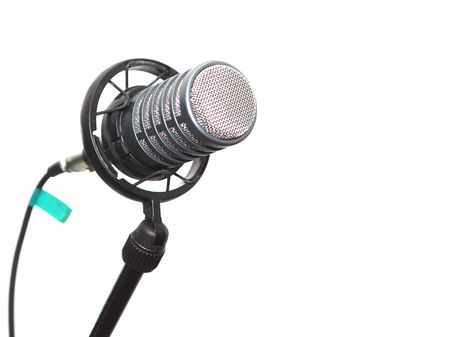 amplify: Microphone on stand in a studio