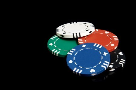 Set of poker chips on a black background photo
