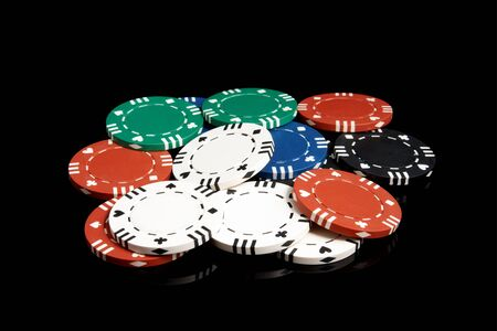red bluff: Set of poker chips on a black background Stock Photo