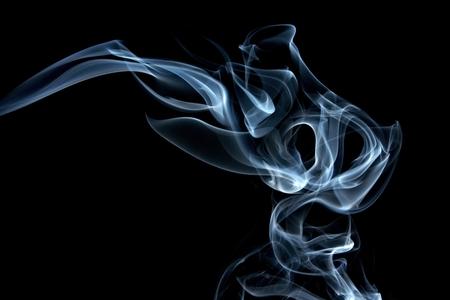 Blue smoke composing to Jinn head on the black background photo