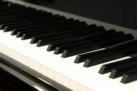 White and black keys of the piano keyboard photo