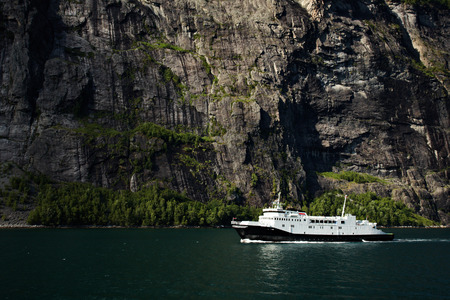 scandinavian peninsula: Ferry in Geirangerfjord in Norway on a sunny day Stock Photo