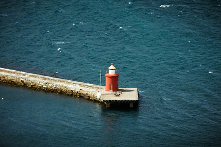 alesund: Lone red lighthouse in Alesund from the top Stock Photo