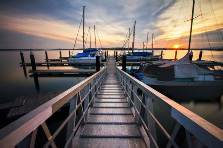 Beautiful sunset view at jetty with yacht