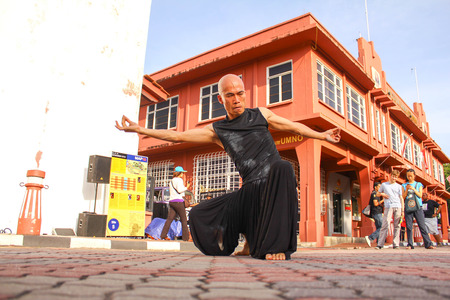 Unknown man doing art performance at Malacca