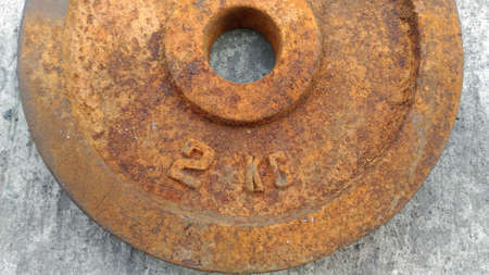 corrode: Rusty iron sheets 2kg on the cement floor and Rust scrub preparations