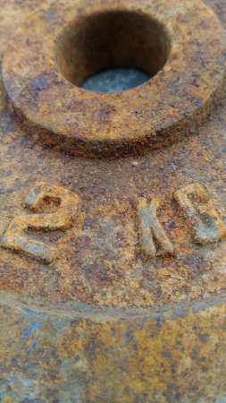 corrode: This is steel plate 2KG the are rusty.Vertical Picture Stock Photo