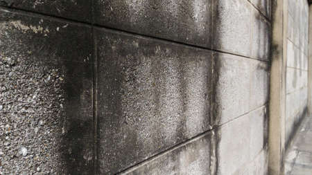 dingy: Wall of an old house Made of brick blocks.Horizontal pictures.