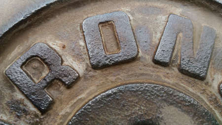corrode: The Sheet metal with letters RON. Sheet metal polishing color off some appear the rusty old.polisheding Rust hen some.