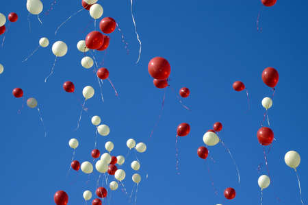 ascent: Balloons released into the sky after a wedding Stock Photo