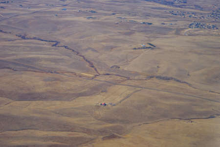 Aerial view of of farm in suburban of Denver in Colorado and the country road