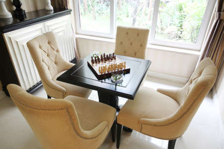 lounge chair in the chess and Stock Photo