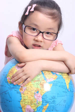 Girl and globe,education and learning photos