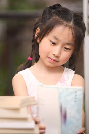 reading of the child, focused homework, asian children photo