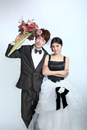 the newlyweds photo in front of a white background, asian characters Stock Photo