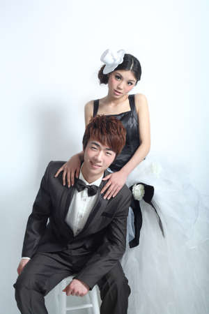 the newlyweds photo in front of a white background, asian characters Stok Fotoğraf