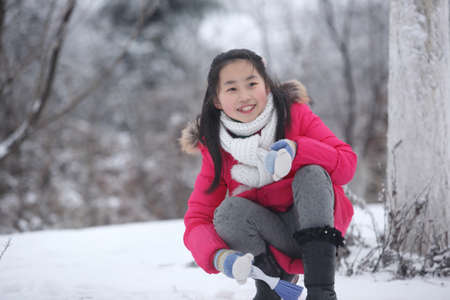 winter photos: winter girl photos, children playing in the snow Stock Photo