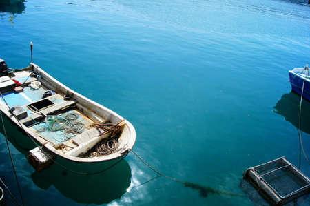 wooden boat: wooden boat at blue sea port