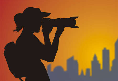 photographer with a camera filming the beautiful scenery, blue-purple city skyline,
