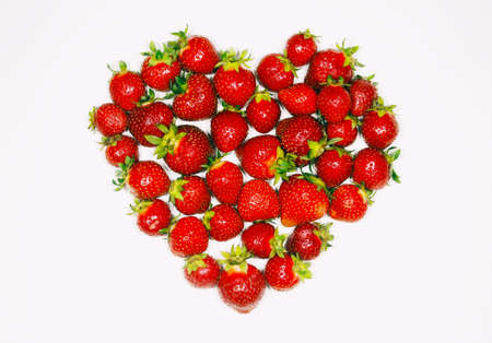 Fresh strawberry, the white background, the line into the heart