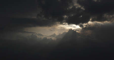 Dark clouds covered the sun, beautiful light from the clouds injection