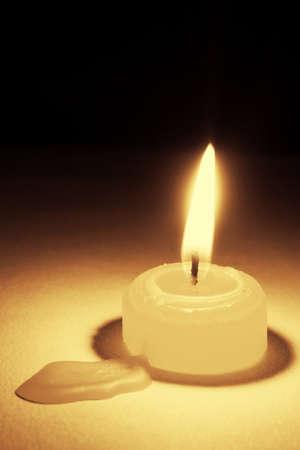 dazzling: White candles, on a black background, dazzling flashing light