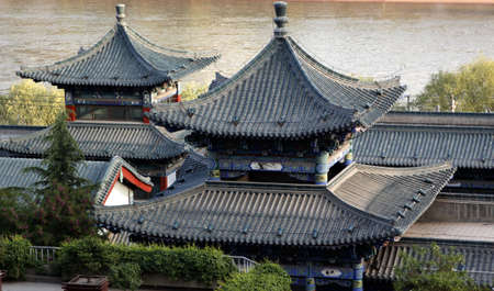 Traditional Chinese ancient architecture of the river  Stock Photo