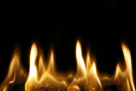 devouring: The golden flame in the darkness of night slowly burning, Stock Photo