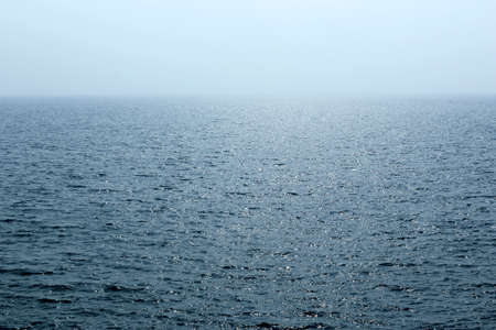 as far as the eye can see: The blue sea, the sea level fuzzy stretch as far as eye can see  Stock Photo