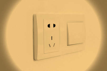 Be sockets and switches on the walls of the halo irradiation Stock Photo - 24196330