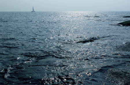 as far as the eye can see: The boat in the blue sea, sailing stretch as far as eye can see the sea, Stock Photo