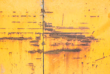 mottled: Yellow paint mottled weathered rusty iron sheet