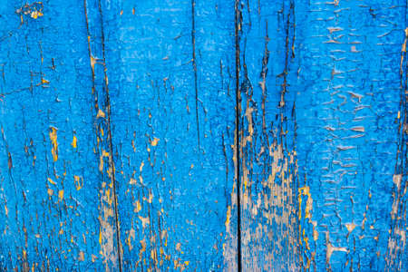 Blue paint mottled weathered rusty wooden doors