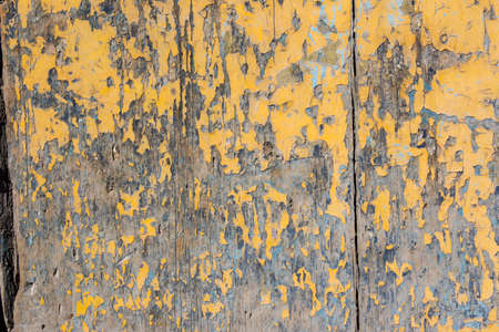 weathering: Yellow mottled paint weathering cracked wooden close-up Stock Photo