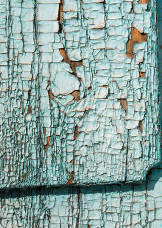 weathering: Green gray color mottled paint weathering cracked wooden close-up Stock Photo