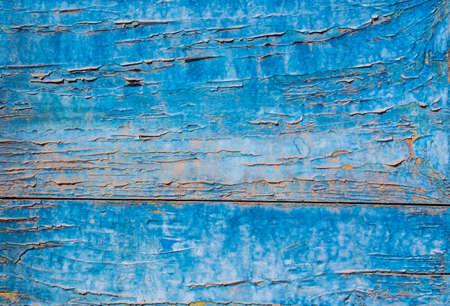 mottled: Blue paint mottled weathered rusty wooden doors