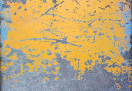 mottled: Yellow mottled paint weathering cracking iron close-up