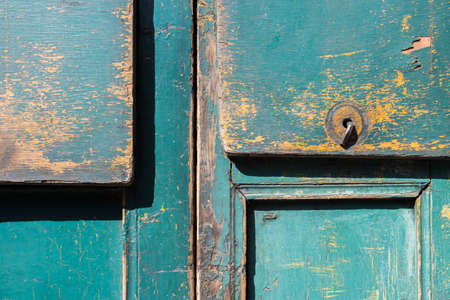 mottled: Green gray color mottled paint weathering cracked wooden close-up Stock Photo