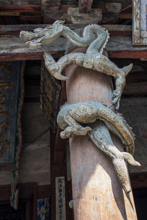 lifelike: A lifelike carvings Chinese dragon hovering on the roof Editorial