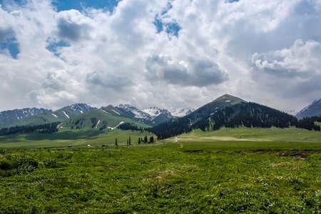 cloud capped: Yili mountains Nalati prairie