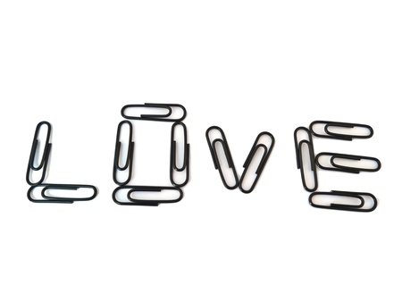 love paper-clip isolated on white background photo