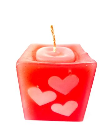 Red candle heart isolated on white background photo