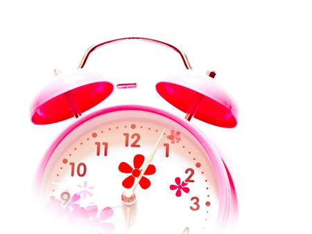an pink alarm clock isolated on white background photo