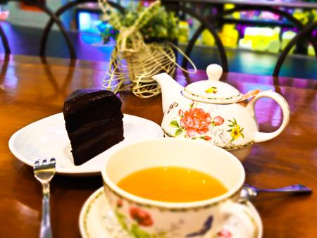 caramel peach Tea and chocolate cake photo